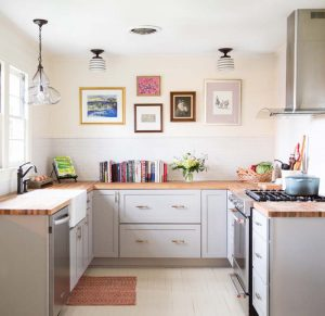 small kitchen with wall frames