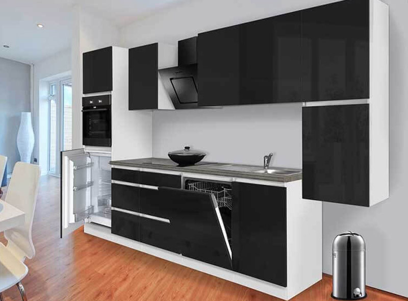 white wall with black kitchen cabinets